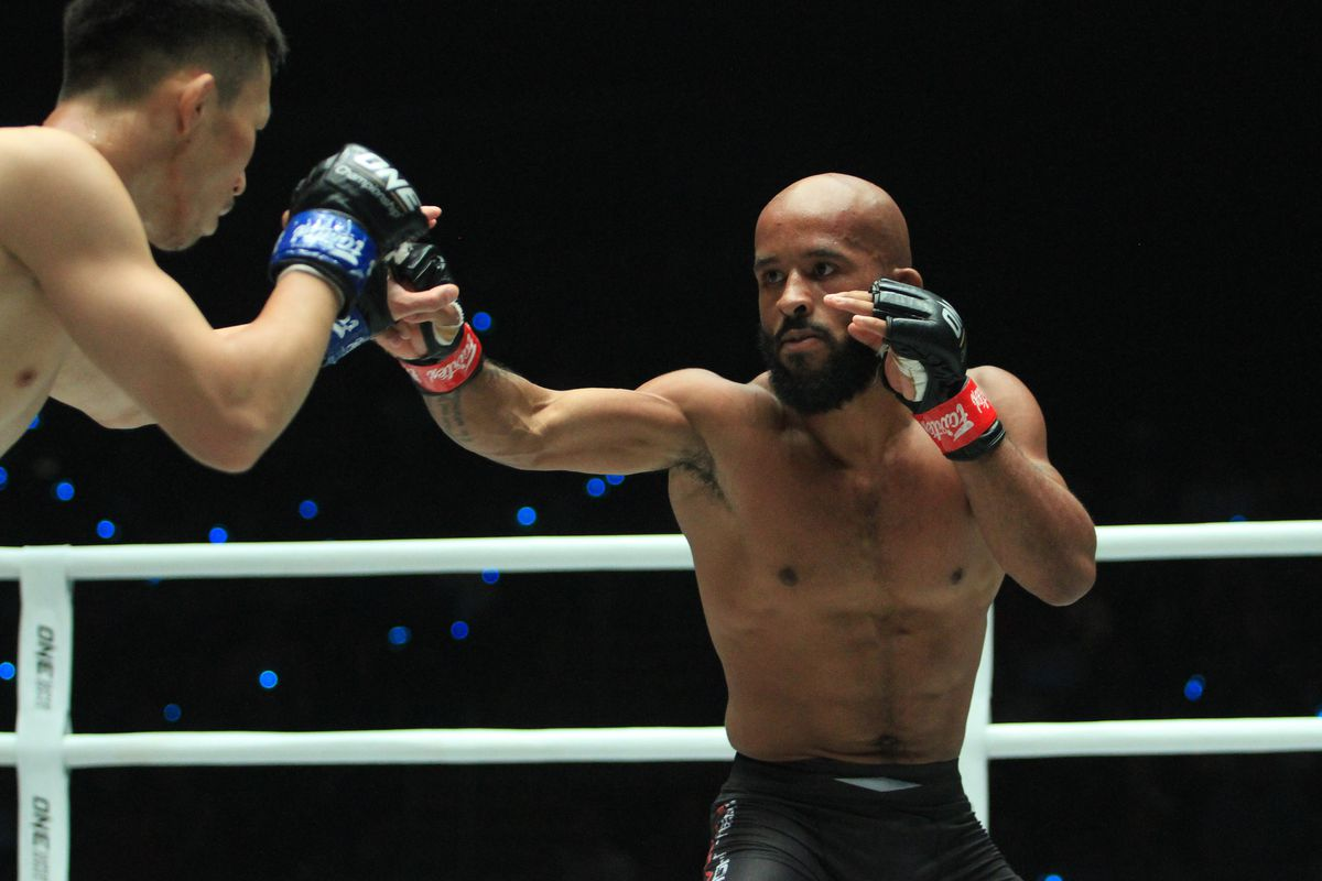 Demetrious Johnson (red gloves), the pound for pound best...