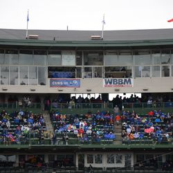 2:12 p.m. Broadcast banners on the press box -