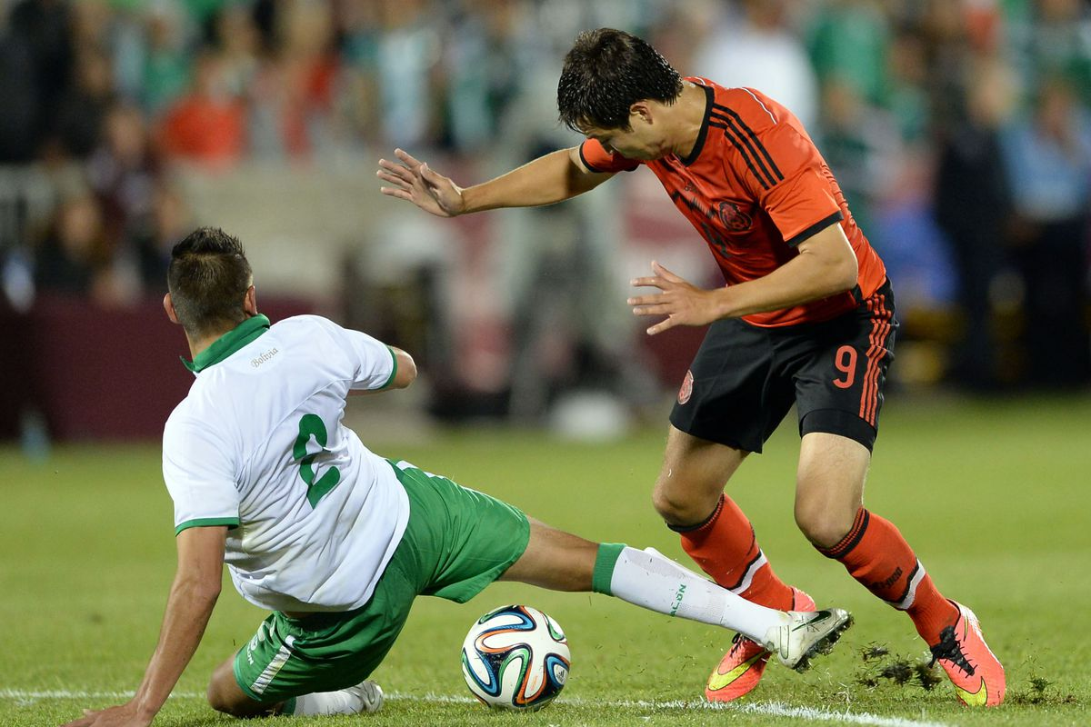 Cubo wearing the iconic gre...er, red for Mexico vs. Bolivia.