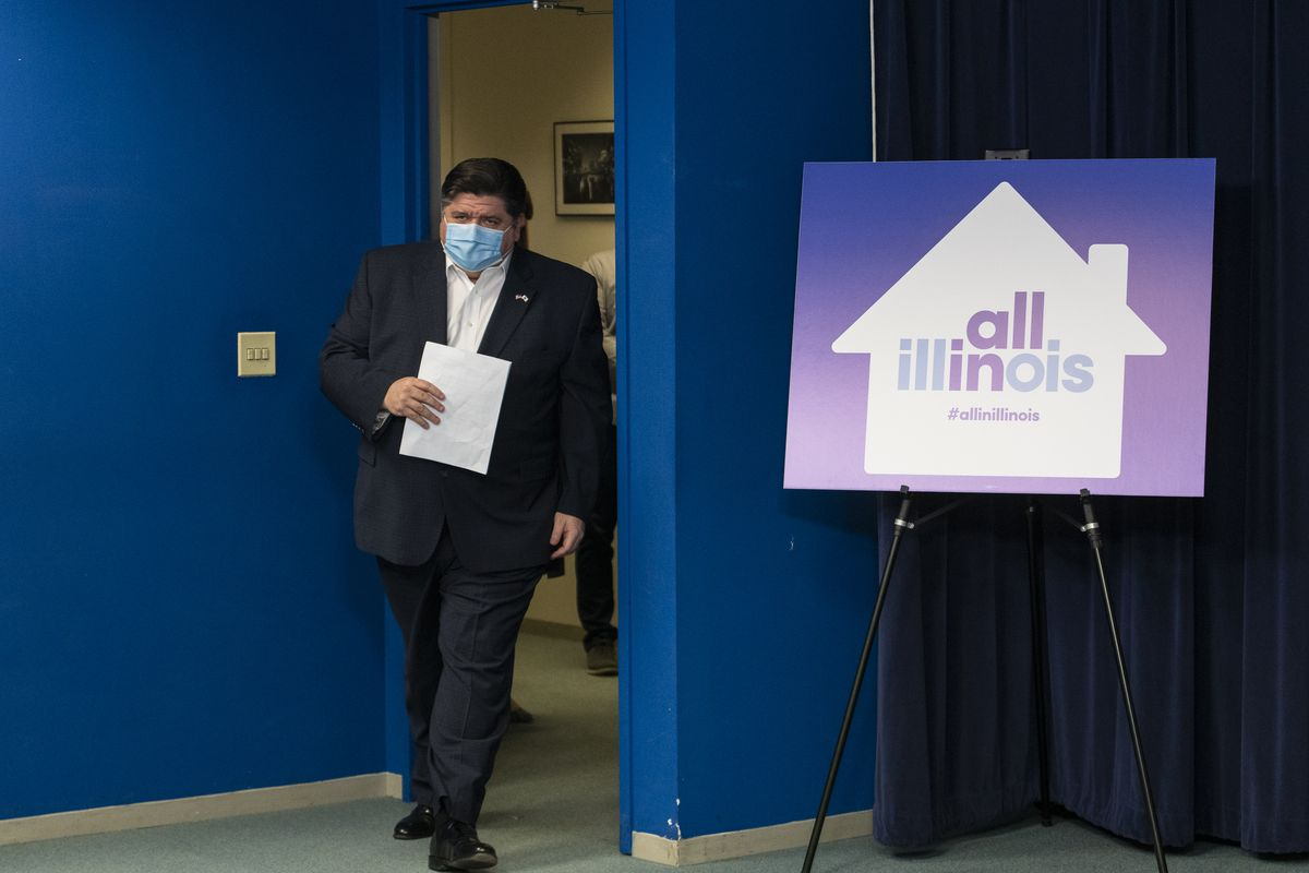 Gov. J.B. Pritzker walks into an April 23 news briefing at the Thompson Center in the Loop.