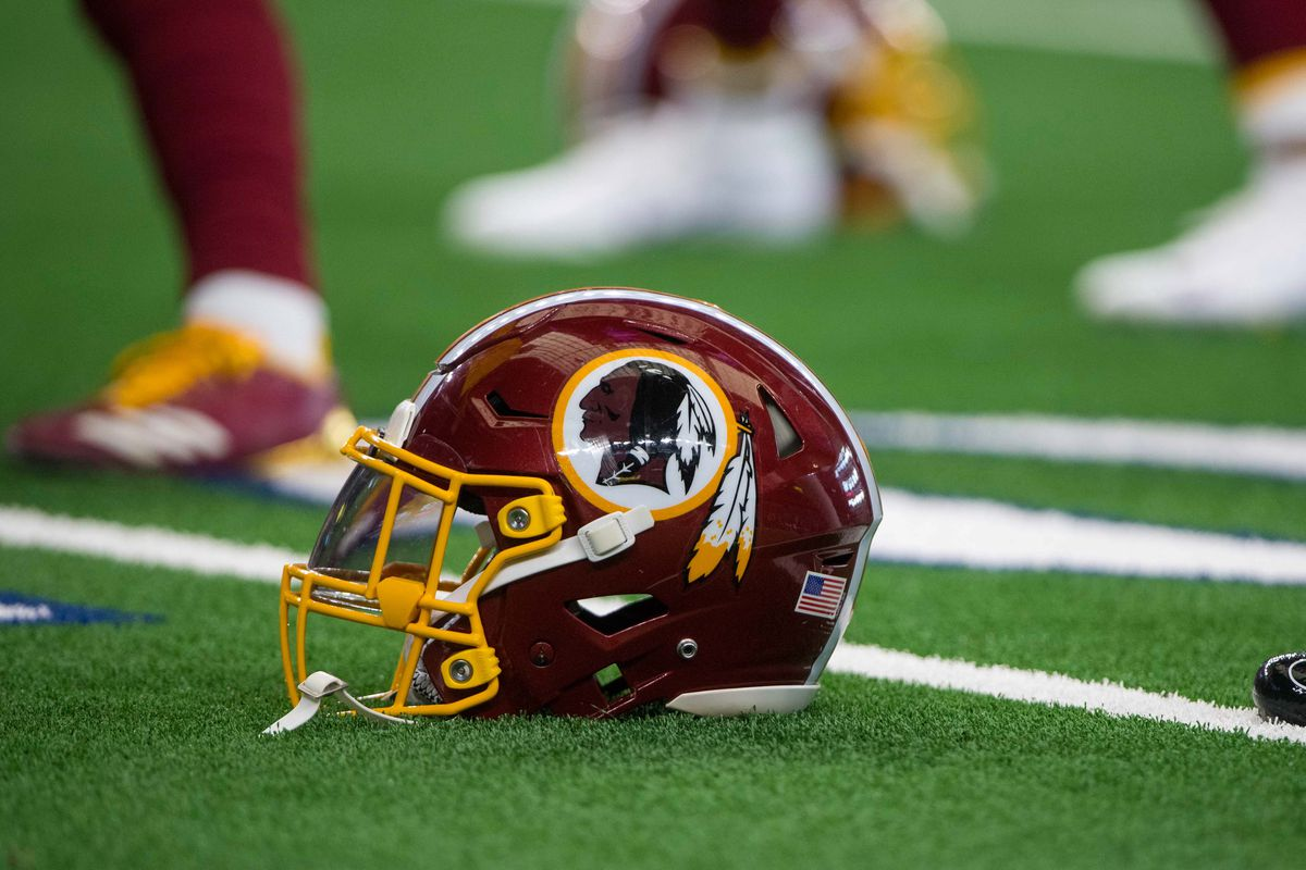 A view of a Washington Redskins helmet and logo before the game between the Dallas Cowboys and Washington Redskins at AT&T Stadium.