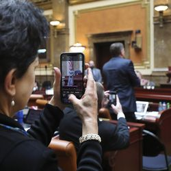 Rep. Patrice Arent, D-Millcreek, takes a photo of a bronze statue depicting former state Sen. Martha Hughes Cannon on the House floor at the Capitol in Salt Lake City on Tuesday, Jan. 28, 2020. The statue is a 25-inch replica of the 7-foot-6-inch statue that will represent Utah at the U.S. Capitol's National Statuary Hall.