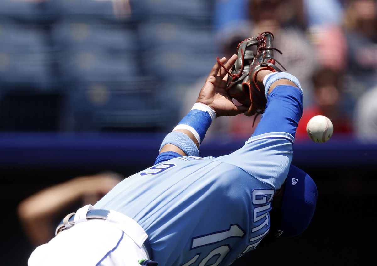Kelvin Gutierrez #19 of the Kansas City Royals misses an infield pop-up during the 1st inning of the game against the Boston Red Sox at Kauffman Stadium on June 20, 2021 in Kansas City, Missouri.