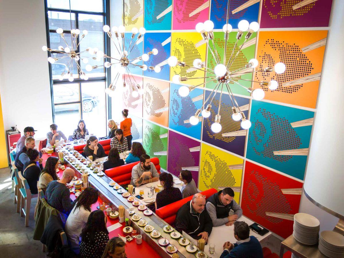 Pop Art–inspired sushi bar with conveyor belt