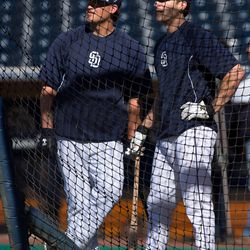 Yasmani Grandal and Chris Denorfia try to gain inspiration as they watch a video of Tony Gwynn's 3000th hit on the jumbotron.