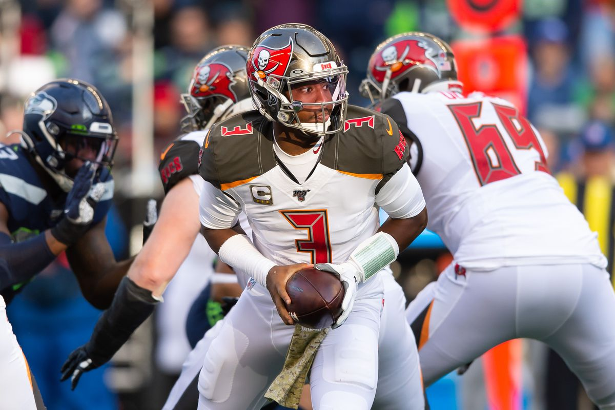 Tampa Bay Buccaneers quarterback Jameis Winston hands off the ball during the second half against the Seattle Seahawks at CenturyLink Field.