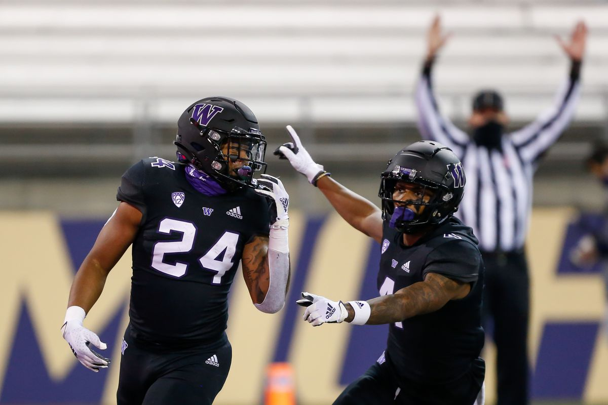Washington Huskies running back Kamari Pleasant celebrates his touchdown with wide receiver Terrell Bynum against the Arizona Wildcats during the third quarter at Alaska Airlines Field at Husky Stadium.