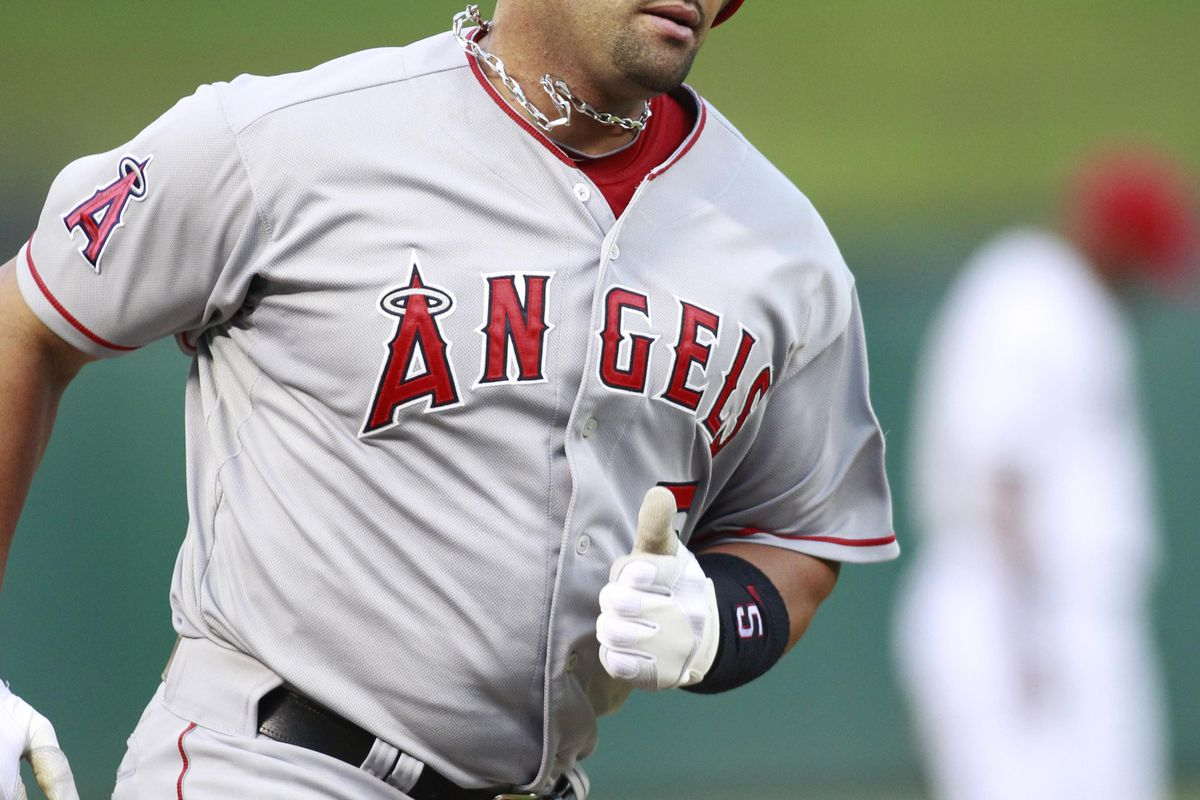 Los Angeles Angels first baseman Albert Pujols rounds third base after hitting a home run in the fourth inning of the game against the Texas Rangers at Rangers Ballpark.
