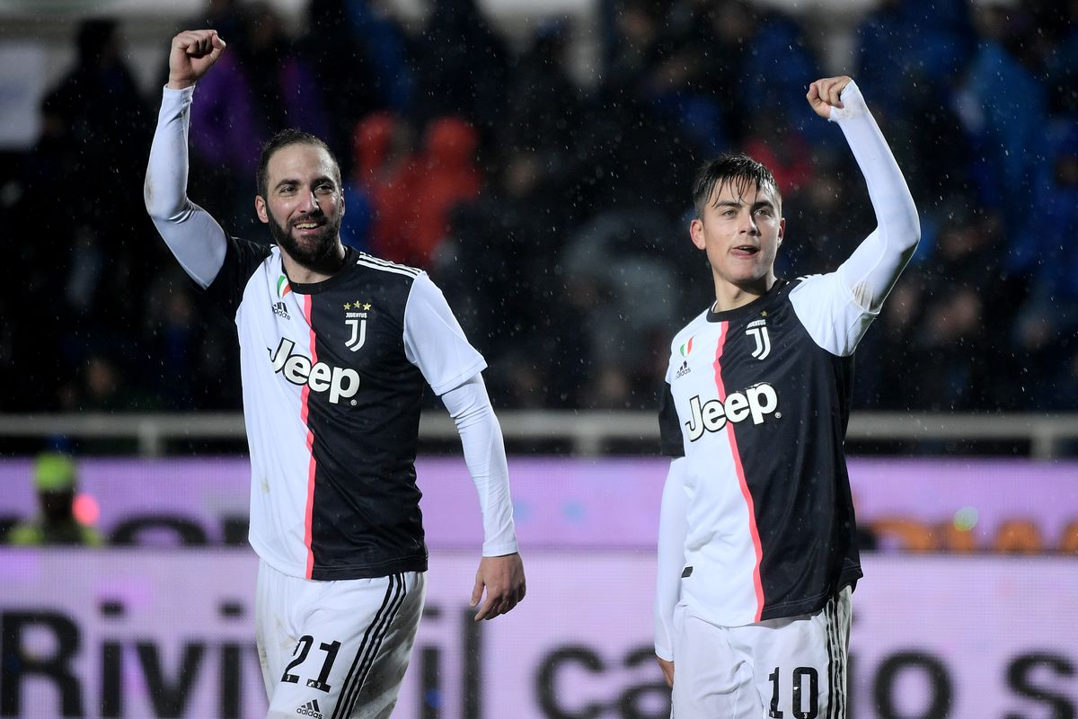 Paulo Dybala of Juventus FC with his teammates Gonzalo...