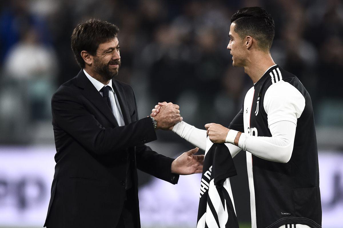 Andrea Agnelli (L) shakes hands with Cristiano Ronaldo of...