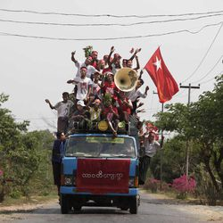 Supporters of Myanmar's pro-democracy leader Aung San Suu Kyi, shout slogans atop a lorry during an election campaign for April 1 by-elections near the village of Wah Thin Kha in Myanmar, Saturday, March 31, 2012.  On Sunday, the tiny village of thatched bamboo huts is expected to help vote the frail but intensely stalwart opposition leader Suu Kyi into public office for the first time, raising the prospect she could win the presidency itself during the next ballot in 2015.