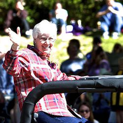 Gail Miller, owner of the Utah Jazz, rides in the parade as spectators watch the floats, horses and celebrities participate in the Days of '47 Parade in Salt Lake City Saturday.