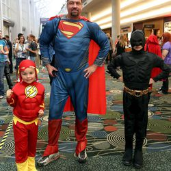 Tavish Place, as Flash, Jeff Place, as Superman, and Atticus Place, as Batman, attend Comic Con at the Salt Palace Convention Center in Salt Lake City on Saturday, Sept. 7, 2013.