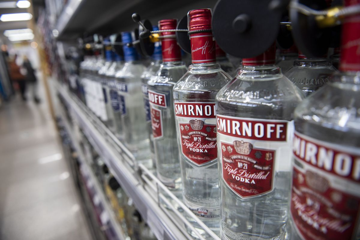 Bottles of Russian Smirnoff vodka are seen displayed at a...