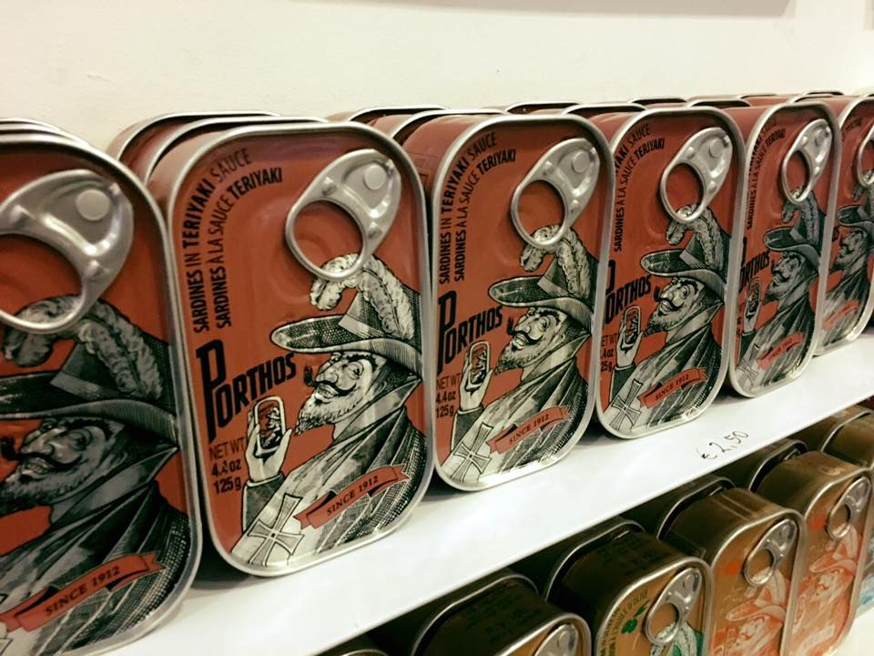 Rows of canned sardines on a shelf