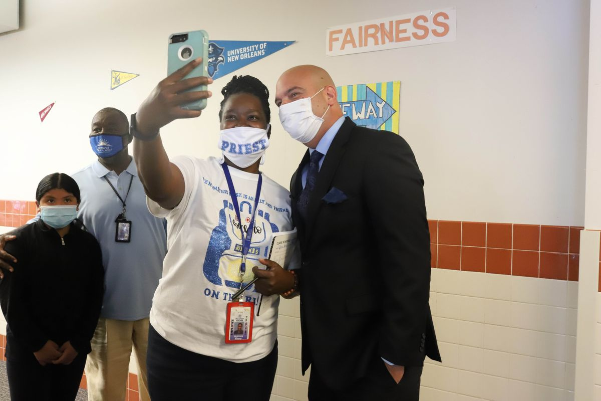 Superintendent Nikolai Vitti poses for a selfie with a teacher at Priest Elementary-Middle School in Detroit.
