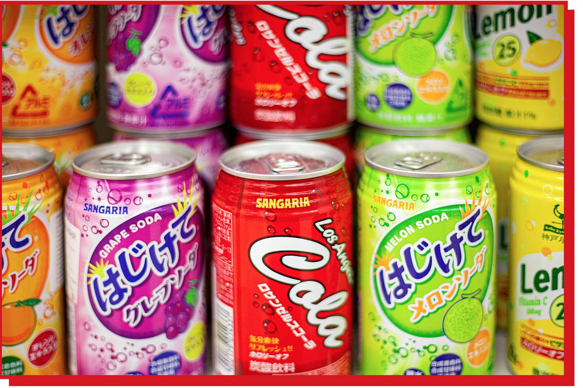 Colorful soda cans on a shelf.