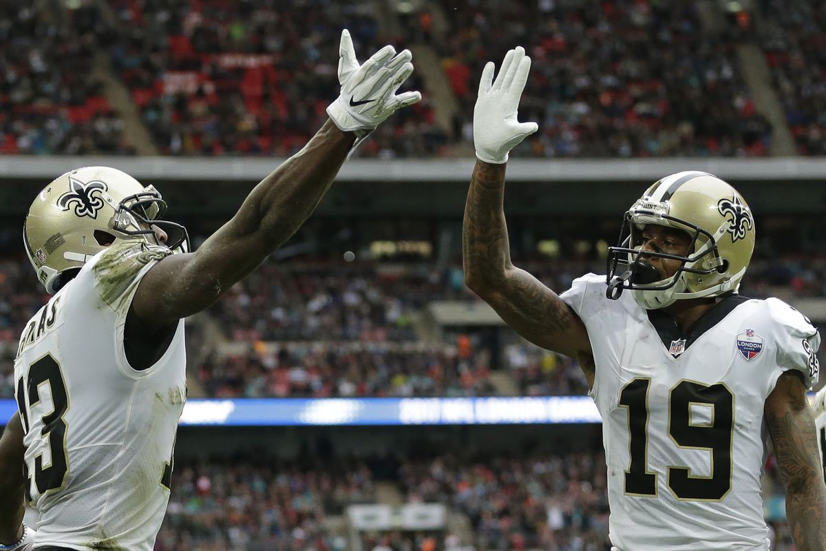 LONDON, ENGLAND - Michael Thomas #13 of the New Orleans Saints celebrates with Ted Ginn  Jnr #19 after scoring the first touchdown during the NFL game between  the Miami Dolphins and the New Orleans Saints at Wembley Stadium.