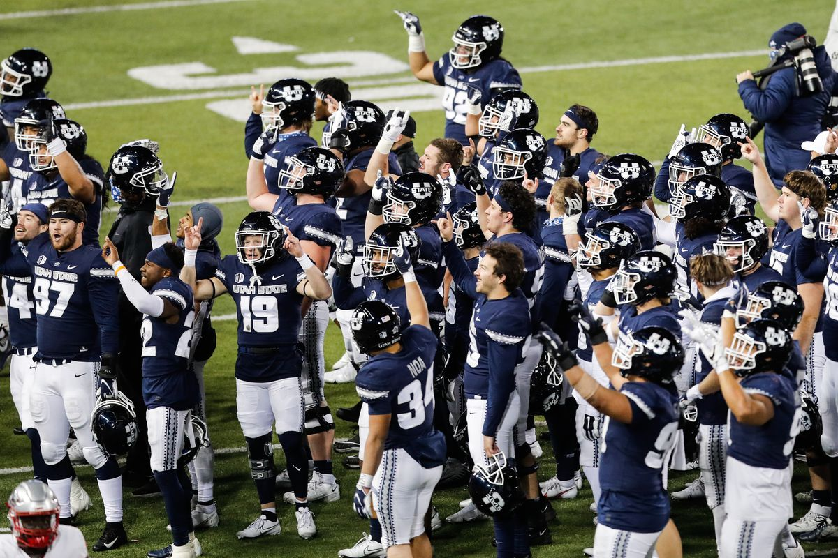 Utah State Aggies players greet their families after defeating New Mexico Lobos 41-27 at Maverik Stadium in Logan on Thursday, Nov. 26, 2020.