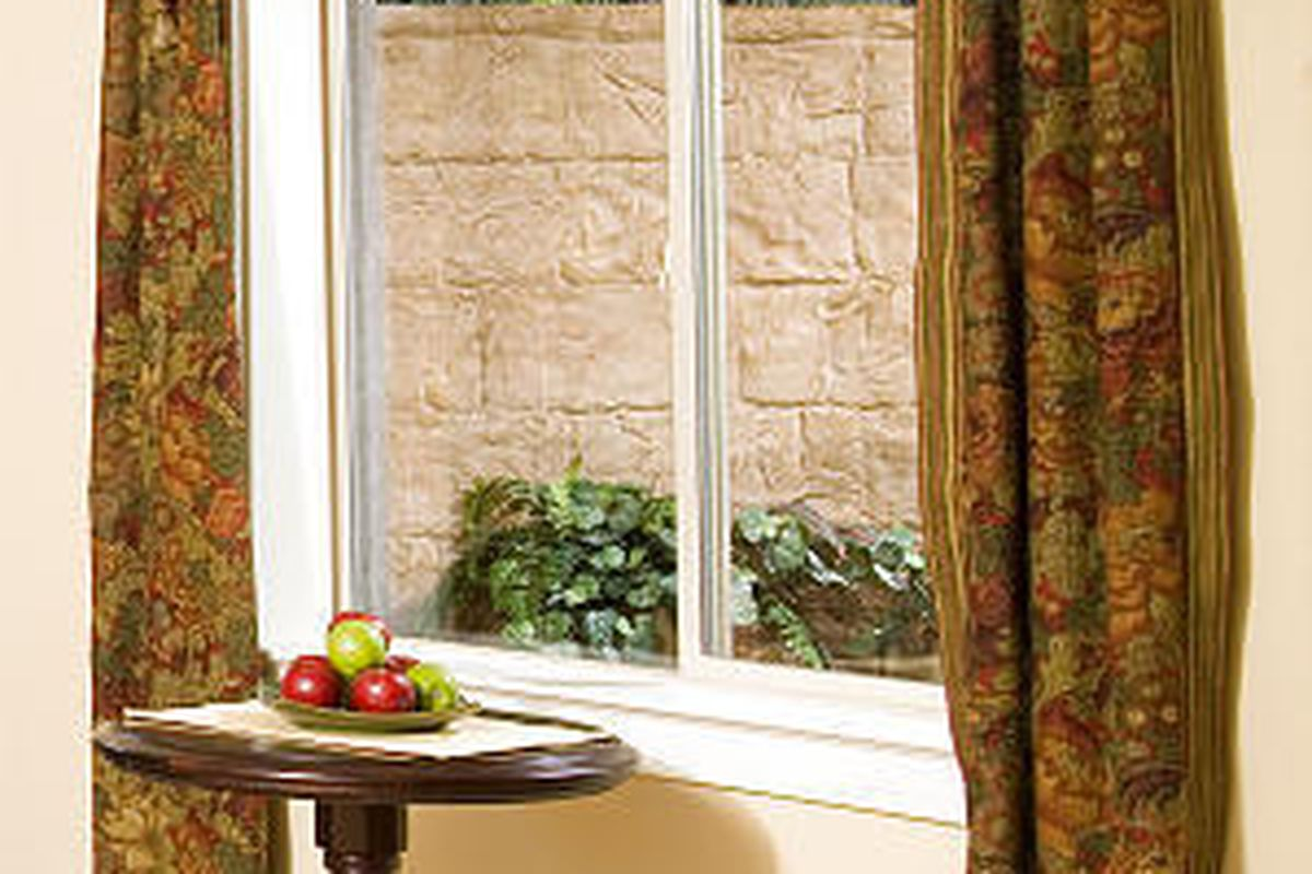 Decorative window wells are an improvement over the drab view from typical basement windows.