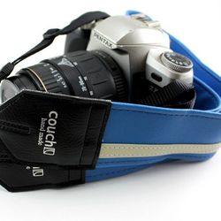 """For the shutterbug: Couch Runway Blue Racer camera strap, <a href=""""http://www.couchguitarstraps.com/camera-straps/the-runway-blue-racer-x-camera-strap.html"""">$26</a>"""