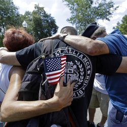 """Members of Teen Challenge, of Brockton, Mass., pray together in a circle after evangelist Franklin Graham held a mass prayer rally on Boston Common, Tuesday, Aug. 30, 2016, in Boston. Graham, the son of famed evangelist Billy Graham, is holding a 50-state """"Decision America"""" tour to urge evangelicals to vote. (AP Photo/Elise Amendola)"""