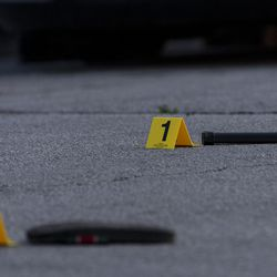 A weapon magazine and a sandal are marked out as evidence at a crime scene where a man was shot in the head and his vehicle stolen in the 6400 block of South Cicero Ave, Monday May 24, 2021.
