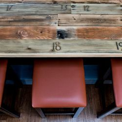 Wood from the old bleachers at UC Berkeley's Memorial Stadium is now a bar top.
