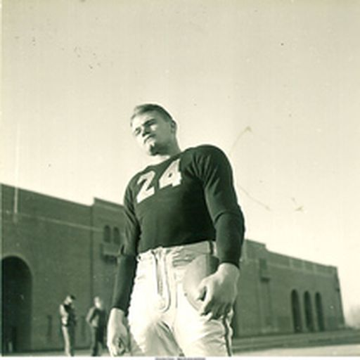 Nile kinnick standing in front of stadium 1939