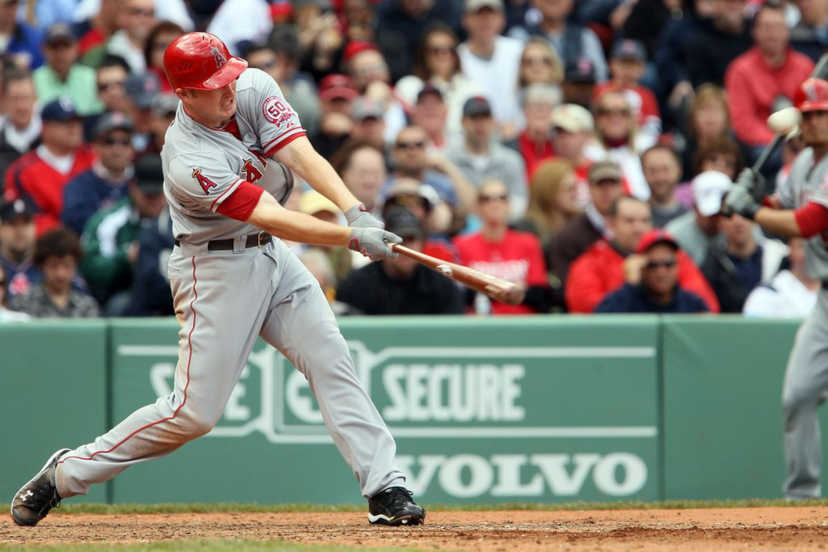 BOSTON, MA - MAY 05:  Mark Trumbo #44 of the Los Angeles Angels hits two run homer against the Boston Red Sox on May 5, 2011 at Fenway Park in Boston, Massachusetts.  (Photo by Elsa/Getty Images)