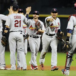 St. Louis Cardinals players celebrate their 6-1 win over the Houston Astros in a baseball game, Monday, Sept. 24, 2012, in Houston.