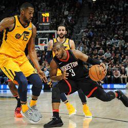 Houston Rockets guard Chris Paul (3) attempts to dribble past Utah Jazz forward Derrick Favors (15) as the Utah Jazz host the Houston Rockets at Vivint Smart Home Arena Salt Lake on Thursday, Dec. 7, 2017.