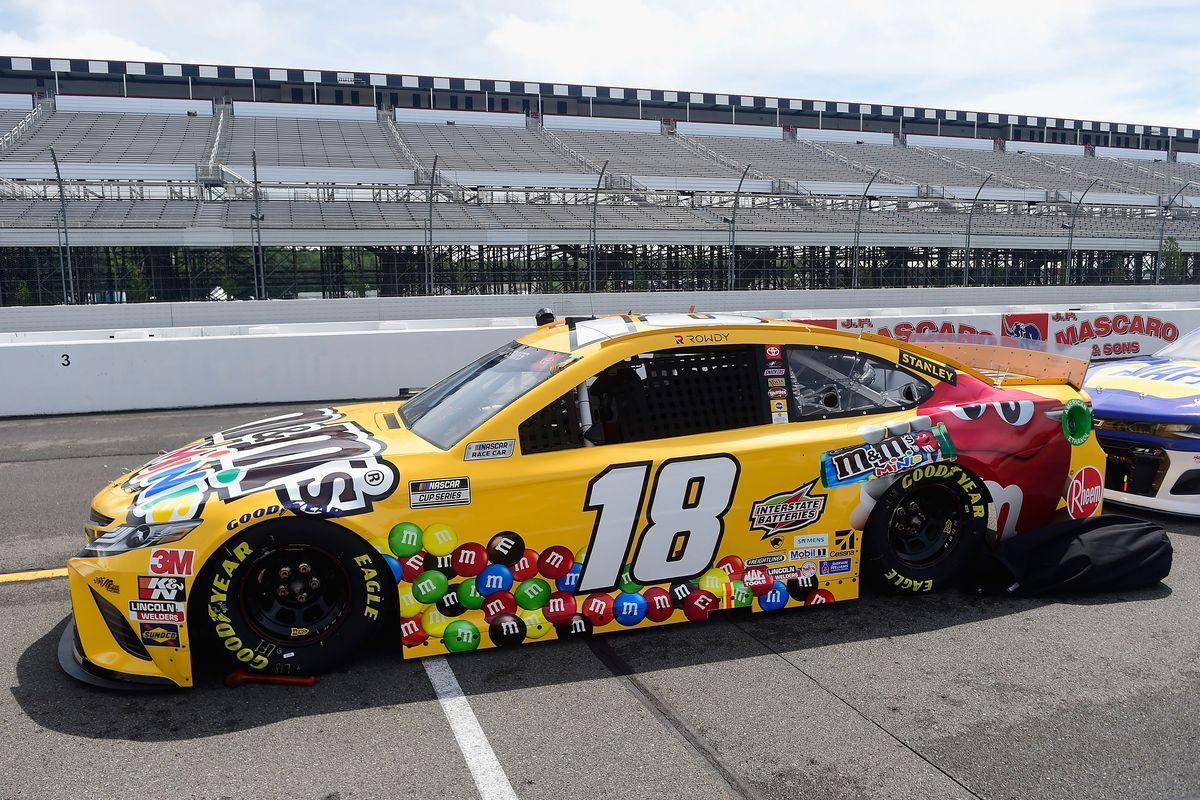 The#18 M&M's Mini's Toyota, driven by Kyle Busch, sits on the grid prior to the NASCAR Cup Series Pocono Organics 325 in partnership with Rodale Institute at Pocono Raceway on June 27, 2020 in Long Pond, Pennsylvania.