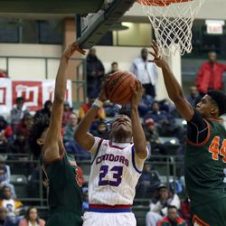 Curie's Ramean Hinton (23) scores between Morgan Park's Deshawndre Washington (24) and Adam Miller (44) during their 65-60 win in the CPS championship at Chicago State University in Chicago, Sunday, February 17, 2019. | Kevin Tanaka/For the Sun Times