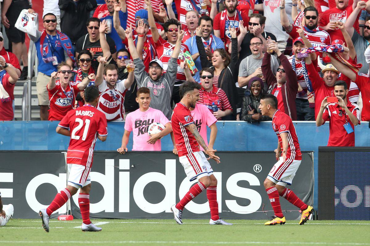 Diaz (right) celebrates a goal with Urruti (center) in Dallas' 2-0 win over the Philadelphia Union in their season opener.
