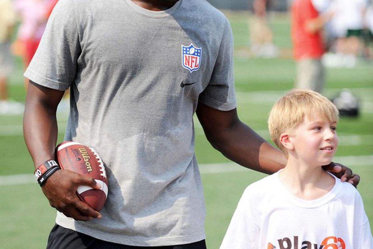 June 29, 2012; Berea, OH USA: Jacksonville Jaguars wide receiver Justin Blackmon talks with a youngster during the AFC rookie symposium at the Cleveland Browns Training Facility.  Mandatory Credit: Eric P. Mull-USPRESSWIRE