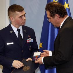 US Staff Sgt. Trevor Donnald Brewer from Gray, Tennessee, left,  is awarded with The Cross of Merit of the Federal Republic of Germany by German Interior Minister Hans-Peter Friedrich in Berlin, Germany, Monday, Jan. 16, 2012. Interior Minister Hans-Peter Friedrich  honored two Americans for helping apprehend an Islamic extremist who attacked a U.S. Air Force bus last year and killed two airmen. Staff Sgt. Trevor Brewer and  Lamar Joseph Conner a civilian airport employee, both of whom chased the suspect after the March 2 shooting, helping police arrest him at the scene.  Arid Uka, a 21-year-old Kosovo Albanian, is currently on trial for the slayings and has admitted to the charges. He faces up to life in prison, and a verdict and sentence are expected Thursday.  Brewer  said he was on the bus when Uka began shooting. The Tennessee native said Uka pointed a pistol at his head and pulled the trigger, but it jammed and didn't fire.