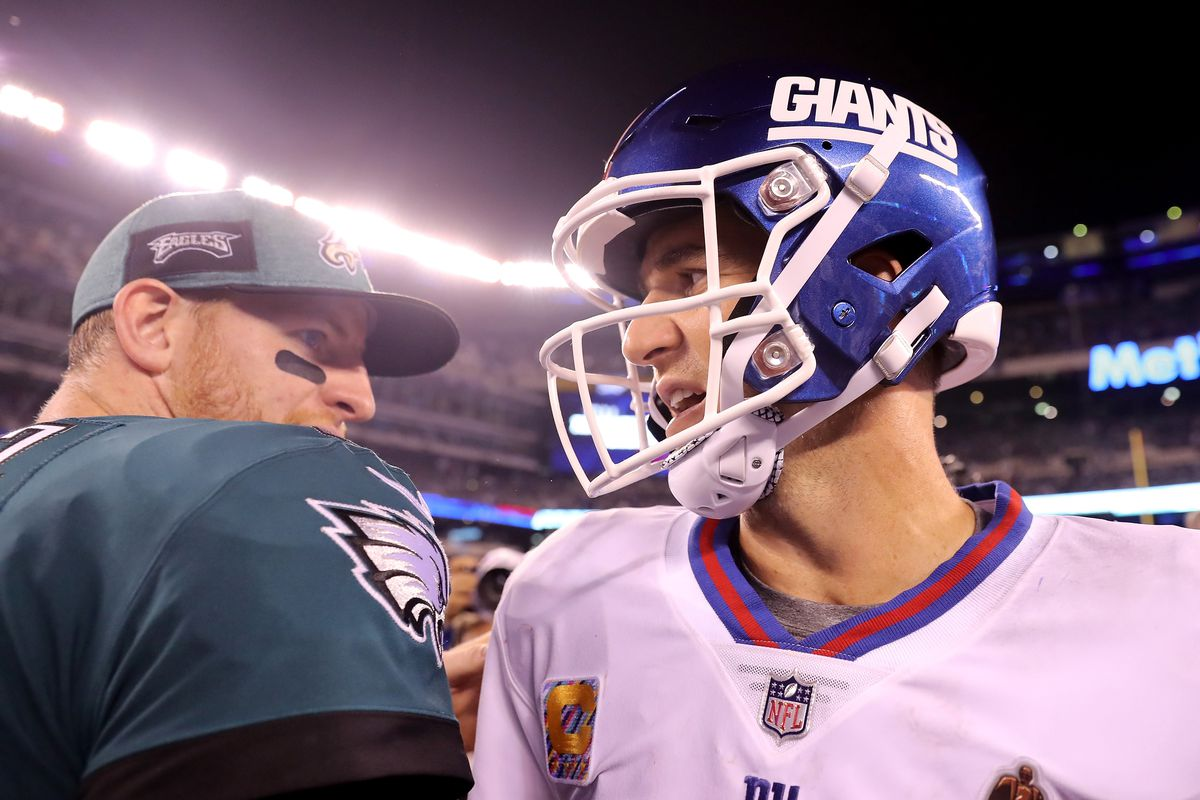 Carson Wentz of the Philadelphia Eagles and Eli Manning of the New York Giants talk after the game on October 11,2018 at MetLife Stadium in East Rutherford, New Jersey.