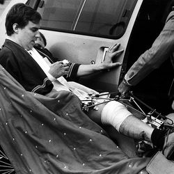 Mark Hofmann was wheeled to court and couldn't hear the judge because of eardrum damage on Nov. 1, 1985