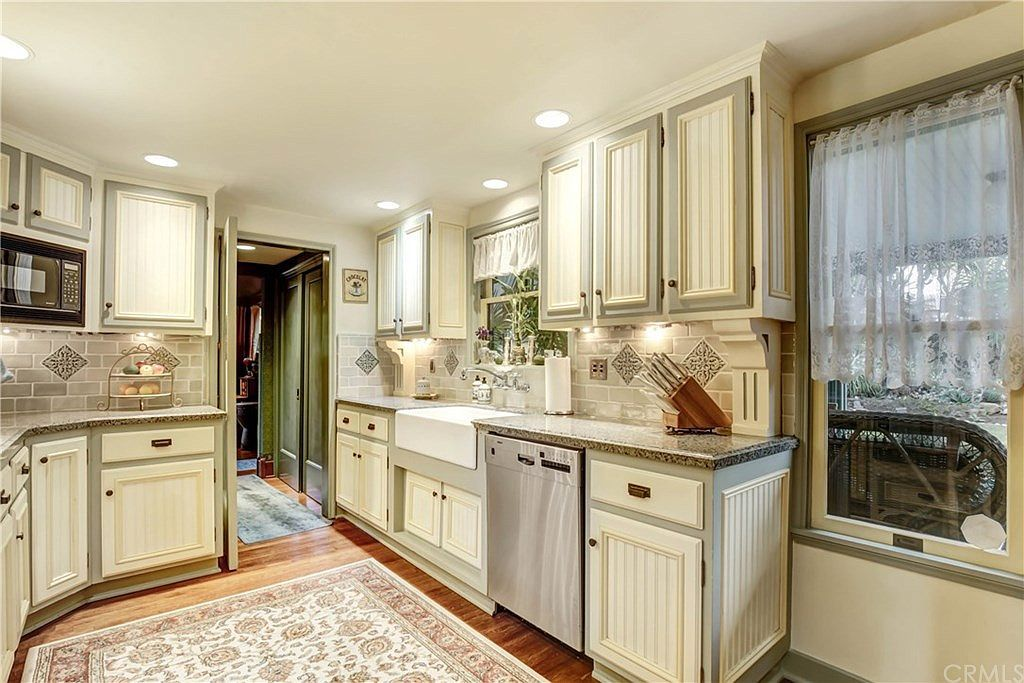 Kitchen with cream-colored cabinetry.