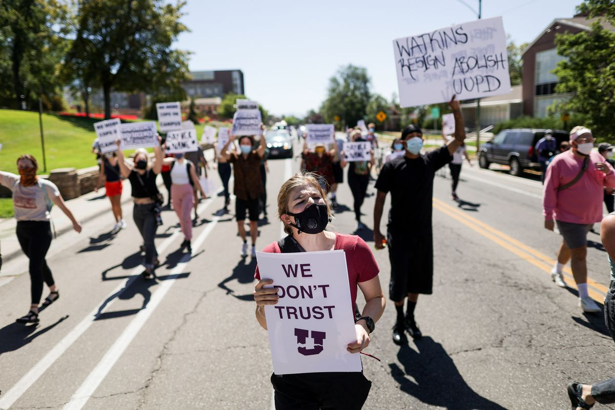 Protesters march from Rice-Eccles Stadium to Presidents Circle at the University of Utah in Salt Lake City on Thursday, Sept. 3, 2020. Responding to the university's handling of the case of slain student Lauren McCluskey, protesters called for the resignation of university president Ruth Watkins, the abolition of the university police department, and a redistribution of police funding into counseling and social services.