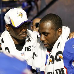 Aug 16, 2013; Orchard Park, NY, USA; Minnesota Vikings running back Adrian Peterson (28) and Buffalo Bills running back C.J. Spiller (28) talk after the game at Ralph Wilson Stadium. Bills beat the Vikings 20-16.