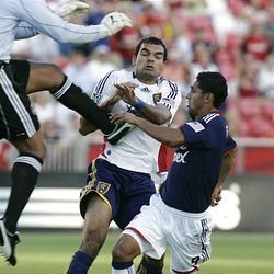 RSL's Pablo Campos, center, is defended by Chivas USA's Zach Thornton, left, and Mariano Trujillo Wednesday at Rio Tinto Stadium.
