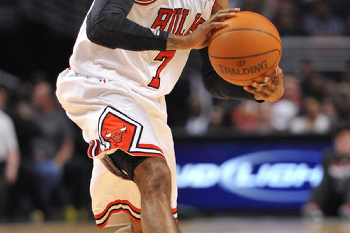 April 16, 2012; Chicago, IL, USA; Chicago Bulls point guard C.J. Watson (7) looks to pass against the Washington Wizards during the second quarter at the United Center.  Mandatory Credit: Rob Grabowski-US PRESSWIRE