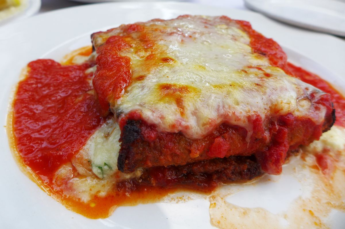 A squarish pile of melted cheese and tomato sauce.