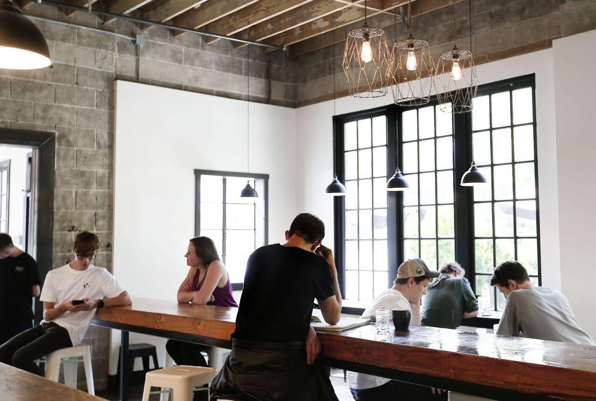 Patrons visit Publik Coffee Roasters in Salt Lake City on Friday, Aug. 20, 2021.