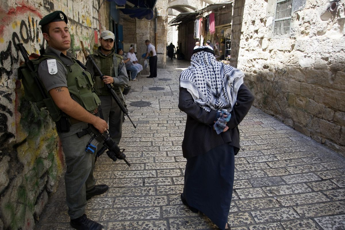 Israeli border policemen patrol the Arab quarter of Jerusalem's Old City on July 23, 2010