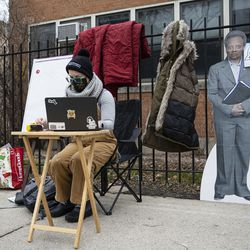 A teacher sets up her laptop outside of Suder elementary to begin virtual classes in solidarity with pre-K educators forced back into the building at 2022 W Washington Blvd in West Town, Monday, Jan. 11, 2021.