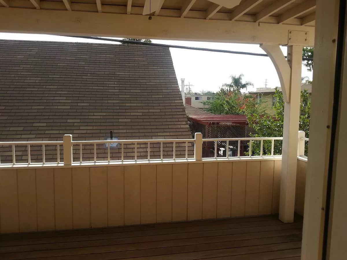 A covered wooden balcony