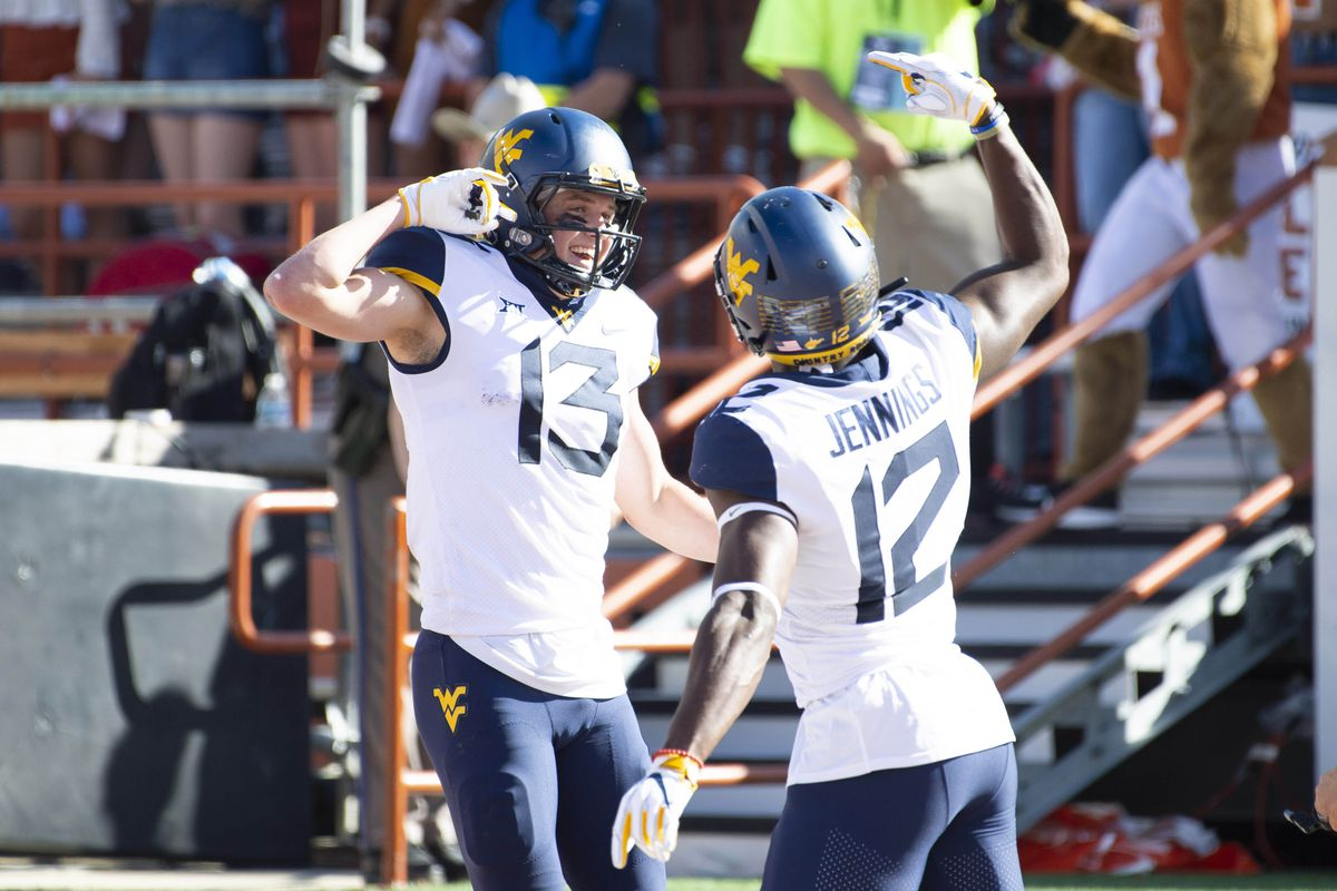 Texas Falls To West Virginia On Two Point Conversion 42 41